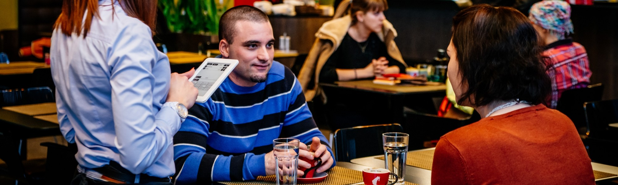 people ordering with tablet, online ordering system, ordering system for restaurants,bars,cafes